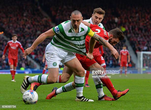 Scott Brown of Celtic is challenged by Graeme Shinnie of Aberdeen during the Betfred Cup Final between Aberdeen FC and Celtic FC at Hampden Park on...