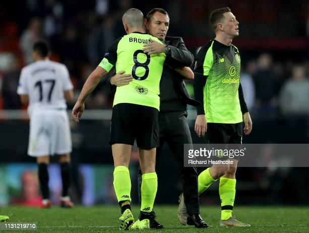 Scott Brown of Celtic is consoled by manager Brendan Rogers during the UEFA Europa League Round of 32 Second Leg match between Valencia v Celtic at...