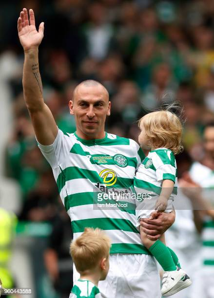 Scott Brown of Celtic is seen with his children during the Scott Brown testimonial match between Celtic and Republic of Ireland XI at Celtic Park on...