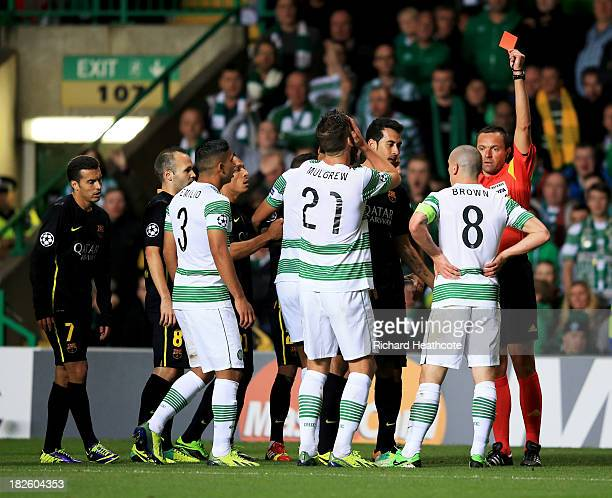 Scott Brown of Celtic is shown a red card and is sent off by referee Stephane Lannoy during the UEFA Champions League Group H match between Celtic...