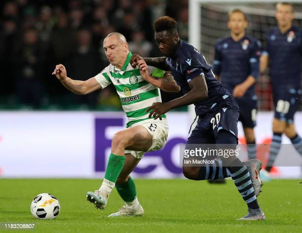 Scott Brown of Celtic is tackled by Felipe Caicedo of Lazio during the UEFA Europa League group E match between Celtic FC and Lazio Roma at Celtic...