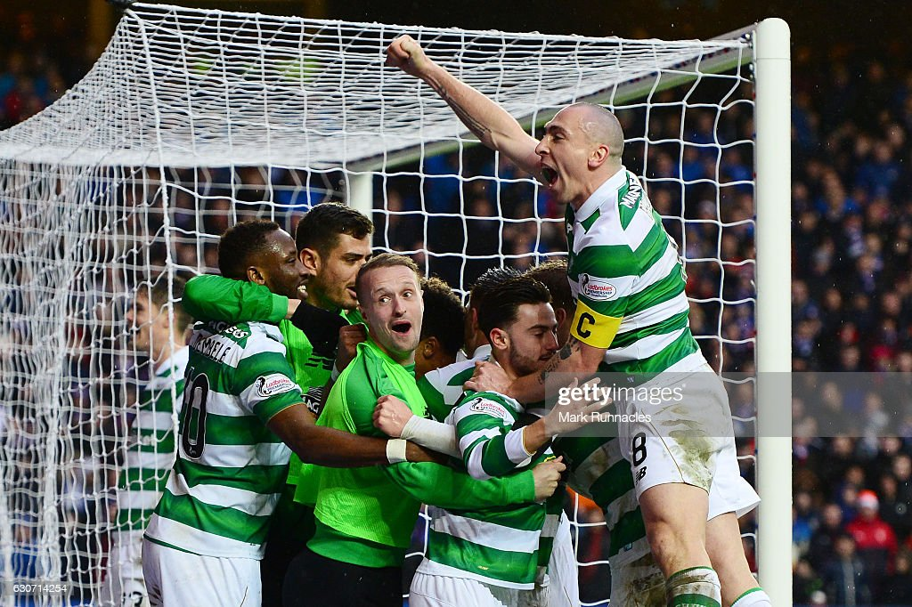 Scott Brown (1st R) of Celtic joins players' celebration after their team's second goal scored by Scott Sinclair during the Ladbrokes Scottish Premiership match between Rangers and Celtic at Ibrox Stadium on December 31, 2016 in Glasgow, Scotland.