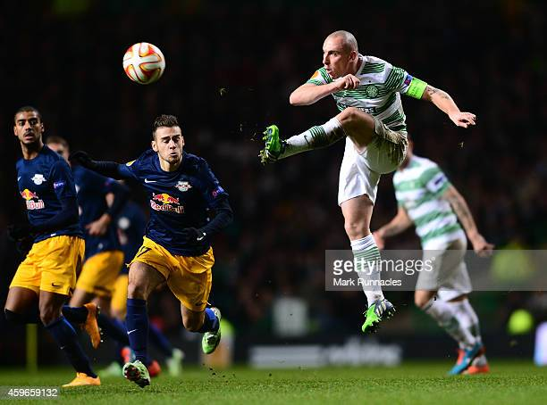 Scott Brown of Celtic keeps the ball moving past Massimo Bruno of FC Salzburg during the UEFA Europa League group D match between Celtic FC and FC...