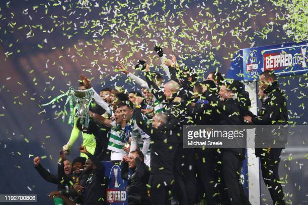 Scott Brown of Celtic lifts the Betfred Cup with his teammates following victory in the Betfred Cup Final between Rangers FC and Celtic FC at Hampden...