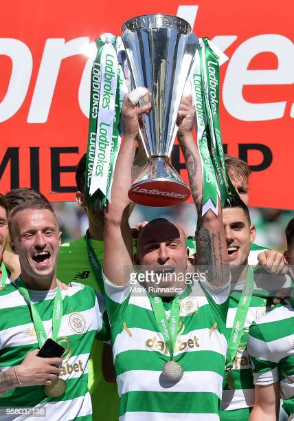 Scott Brown of Celtic lifts the Ladbrokes Scottish Premier League trophy as Celtic take the title during the Scottish Premier League match between...