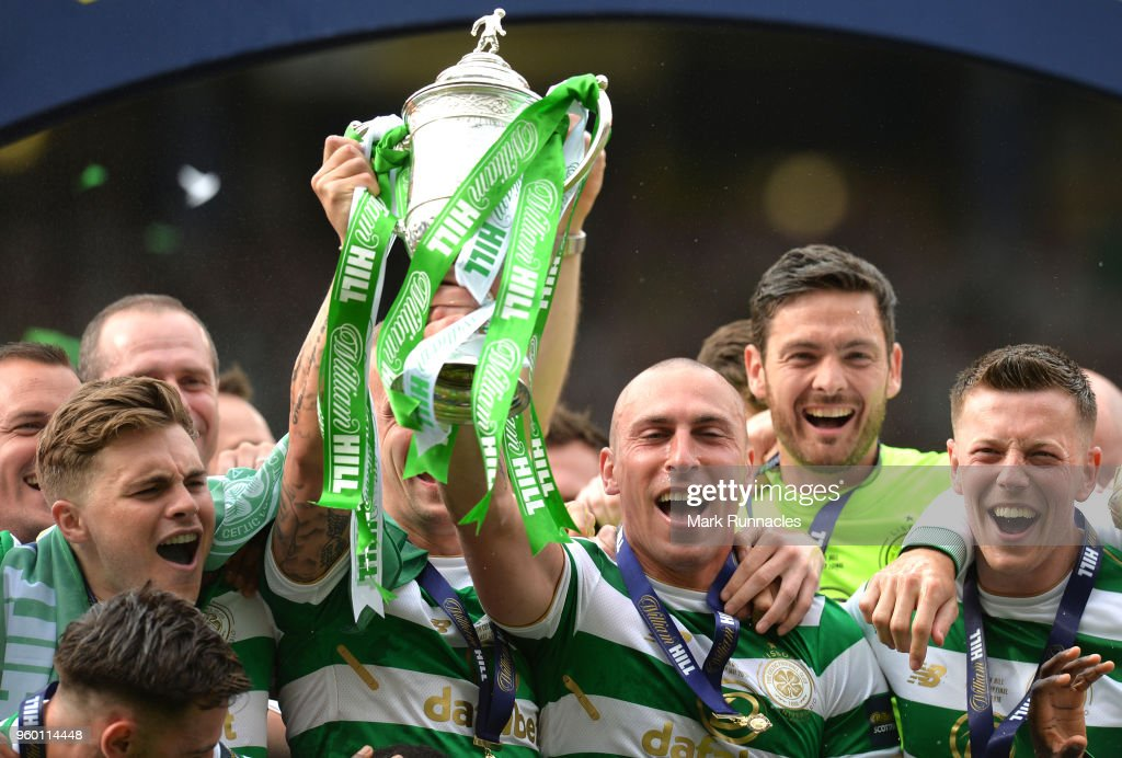 Scott Brown of Celtic lifts the Scottish Cup Trophy following his side's win at the Scottish Cup Final between Motherwell and Celtic at Hampden Park on May 19, 2018 in Glasgow, Scotland.