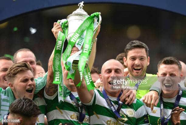 Scott Brown of Celtic lifts the Scottish Cup Trophy following his side's win at the Scottish Cup Final between Motherwell and Celtic at Hampden Park...