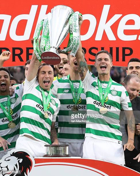 Scott Brown of Celtic lifts the Scottish Premier League trophy during the Scottish Premier league match between Celtic and Hearts at Celtic Park on...