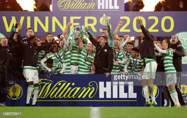 Scott Brown of Celtic lifts the William Hill Scottish Cup with teammates after victory in a penalty shoot out in the William Hill Scottish Cup final...