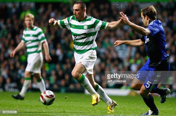 Scott Brown of Celtic tackles Joris Mathijsen of Hamburger SV during the UEFA Europa League Group C match between Celtic and Hamburg at Celtic Park...
