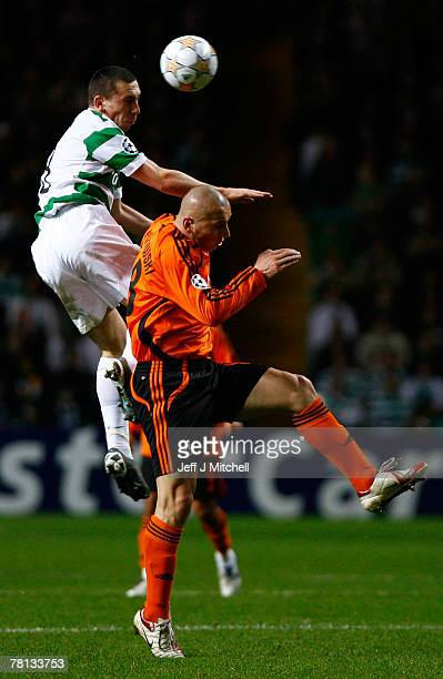 Scott Brown of Celtic tackles Mariusz Lewandowski of Shakhtar Donetsk during the UEFA Champions League Group D match between Celtic and Shakhtar...