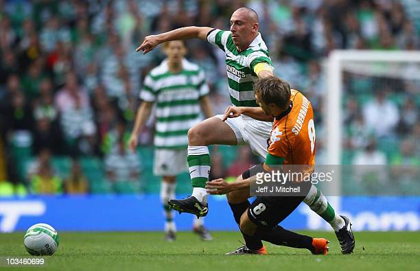 Scott Brown of Celtic tackles Michael Silberbauer of FC Utrecht during the UEFA Europa League Play Off match between Celtic and FC Utrecht at Celtic...