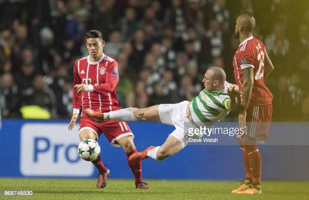 Scott Brown of Celtic takes a wild swing at the ball during the Champions League group B match between Celtic FC and Bayern Muenchen at Celtic Park...