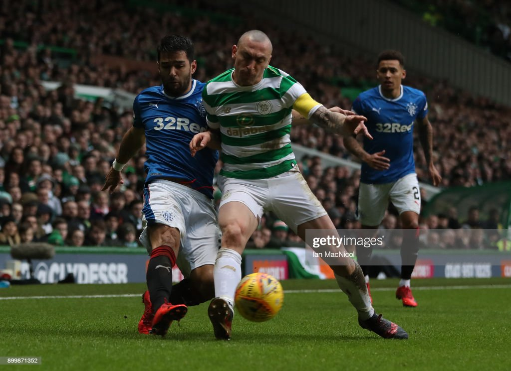 Scott Brown of Celtic vies with Daniel Candeias of Rangers during the Scottish Premier League match between Celtic and Ranger at Celtic Park on December 30, 2017 in Glasgow, Scotland.
