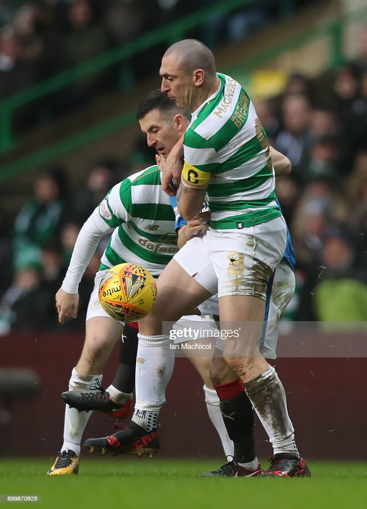 Scott Brown of Celtic vies with Jason Holt of Rangers during the Scottish Premier League match between Celtic and Ranger at Celtic Park on December 30, 2017 in Glasgow, Scotland.