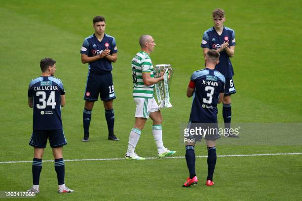 Scott Brown of Celtic walks onto the pitch with the Premiership Trophy during the Ladbrokes Premiership match between Celtic and Hamilton Academical...