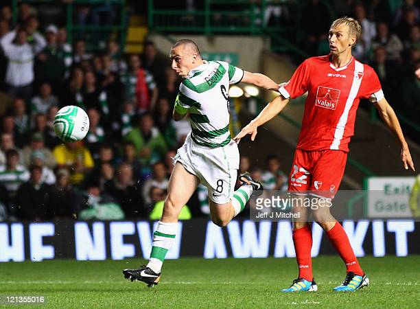 Scott Brown of of Celtic shoots at goal as Goran Obradovic of FC Sion looks on during the UEFA Europa League qualifying round first leg match between...