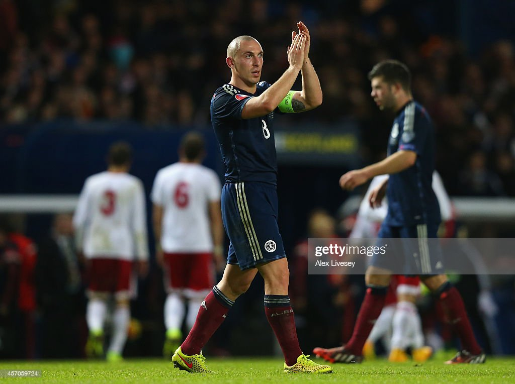 Scott Brown of Scotland celebrates after the EURO 2016 Qualifier match between Scotland and Georgia at Ibrox Stadium on October 11, 2014 in Glasgow, Scotland.