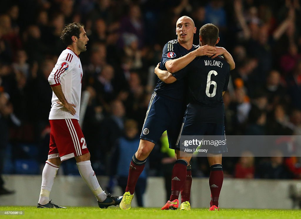 Scott Brown of Scotland celebrates with Shaun Maloney after the EURO 2016 Qualifier match between Scotland and Georgia at Ibrox Stadium on October 11, 2014 in Glasgow, Scotland.