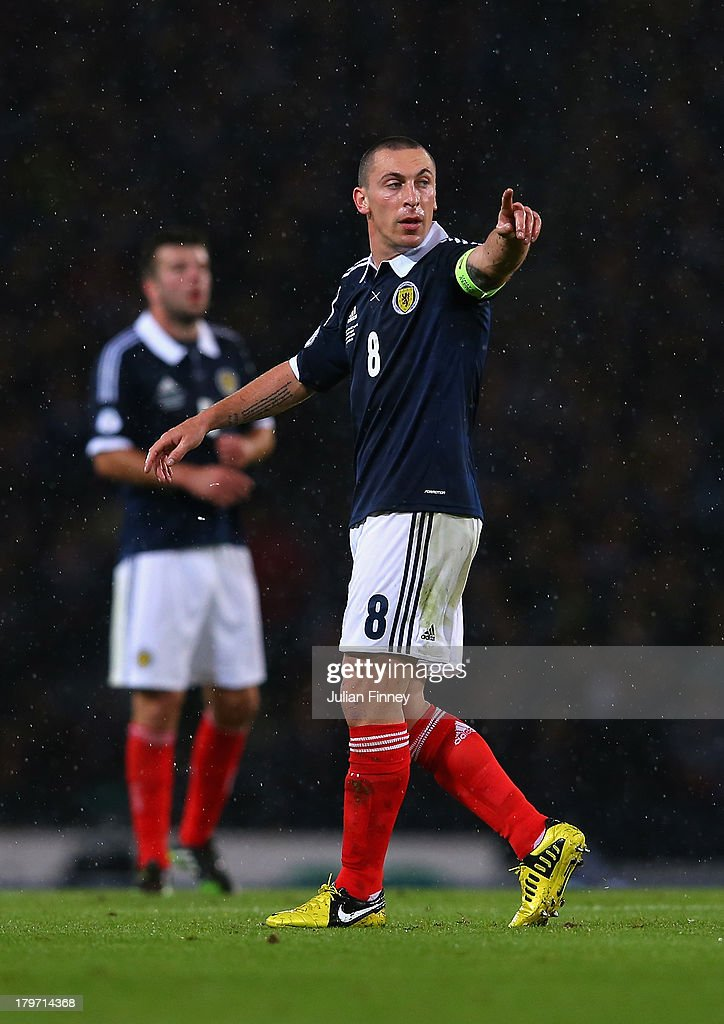 Scott Brown of Scotland points directions during the FIFA 2014 World Cup Qualifying Group A match between Scotland and Belgium at Hampden Park on September 6, 2013 in Glasgow, Scotland.