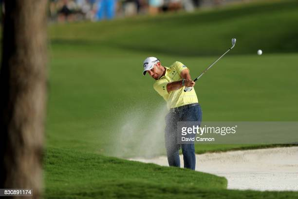 Scott Brown of the United States plays his second shot on the par 4 18th hole during the third round of the 2017 PGA Championship at Quail Hollow on...