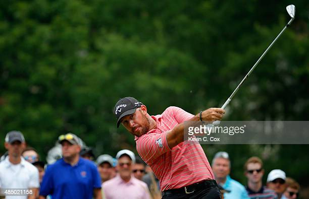 Scott Brown tees off on the third hole during the final round of the Wyndham Championship at Sedgefield Country Club on August 23, 2015 in...