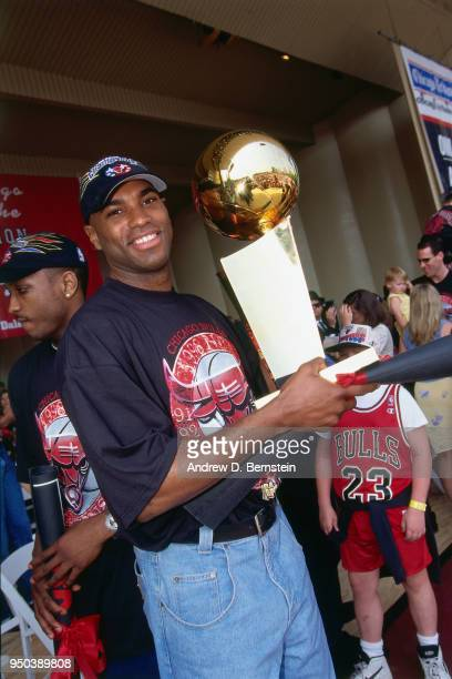 Scott Burrell of the Chicago Bulls with the Larry O'Brien NBA Championship Trophy during the 1998 Chicago Bulls Celebration Rally on June 16 1998 at...