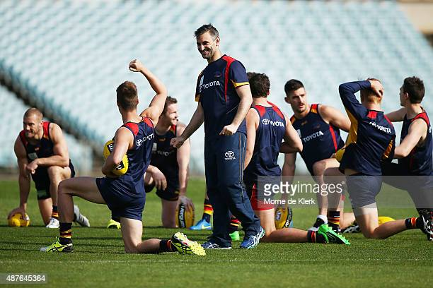 Scott Camporeale coach of the Crows shares a laugh with his players during an Adelaide Crows AFL training session at AAMI Stadium on September 11...