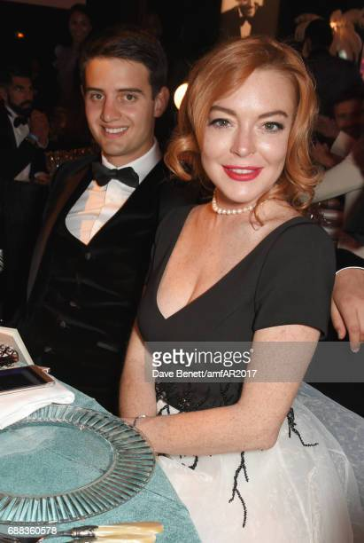 Scott Carlsen and Lindsay Lohan attend the amfAR Gala Cannes 2017 at Hotel du CapEdenRoc on May 25 2017 in Cap d'Antibes France