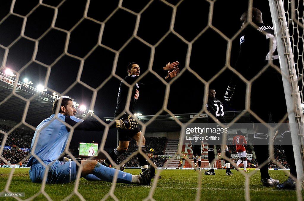 Scott Carson and Paul Scharner of West Bromwich Albion react after Rory Delap of Stoke City scored the opening goal during the Barclays Premier League match between Stoke City and West Bromwich Albion at The Britannia Stadium on February 28, 2011 in Stoke on Trent, England.