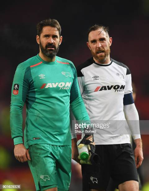 Scott Carson and Richard Keogh of Derby County look dejected in defeat after the Emirates FA Cup Third Round match between Manchester United and...