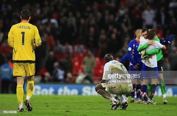 Scott Carson and Sol Campbell of England look dejected as the Croatian players celebrate after the Euro 2008 Group E qualifying match between England...