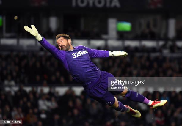 Scott Carson dives during the Sky Bet Championship match between Derby County and Norwich City at Pride Park Stadium on October 3 2018 in Derby...