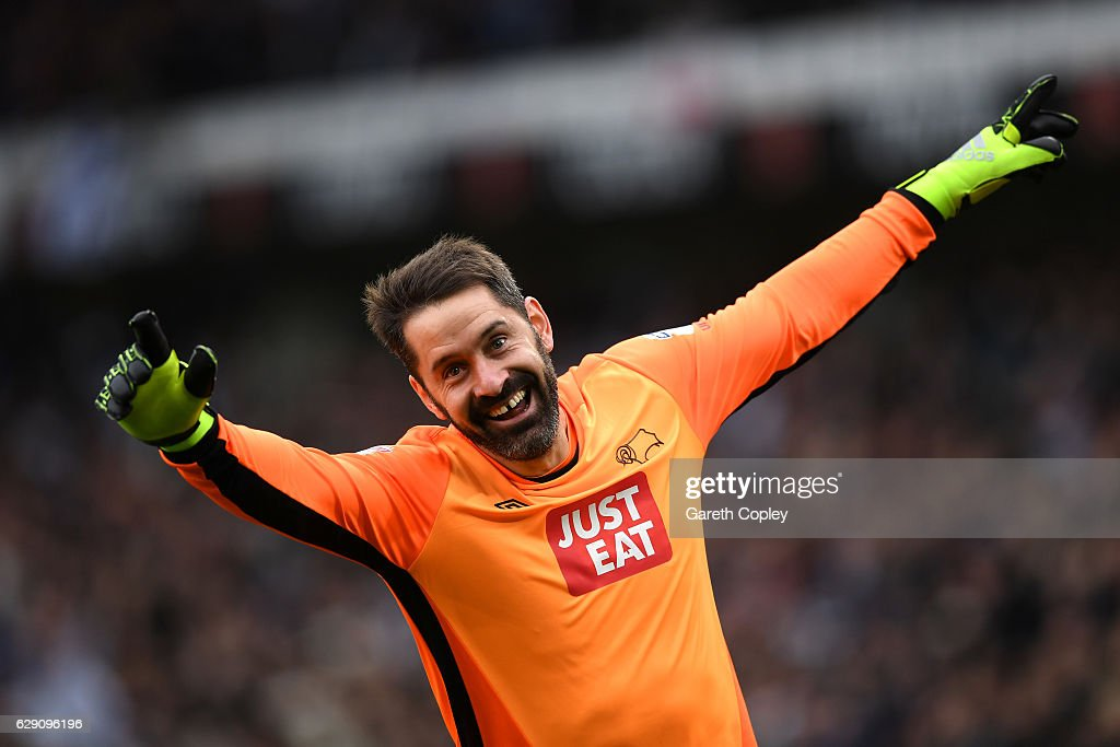 Scott Carson of Derby County celebrates after Tom Ince of Derby County (not pictured) scores his side's second during the Sky Bet Championship match between Derby County and Nottingham Forest at iPro Stadium on December 11, 2016 in Derby, England.