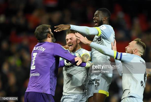 Scott Carson of Derby County celebrates with teammates after he saves Manchester United's eighth penalty from Phil Jones during a penalty shoot out...