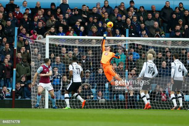 Scott Carson of Derby County saves from a header by James Chester of Aston Villa during the Sky Bet Championship match between Aston Villa and Derby...