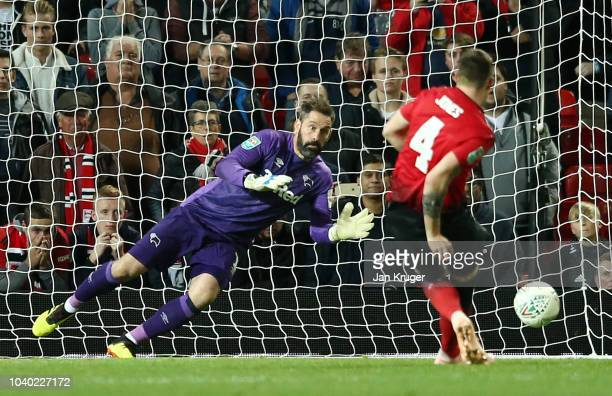 Scott Carson of Derby County saves the Eighth penalty from Phil Jones of Manchester United putting Derby County through to the next round of the cup...
