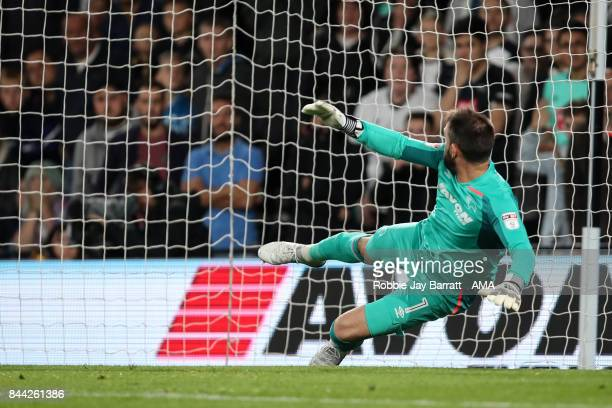 Scott Carson of Derby County watches the ball go over the crossbar as Sebastian Larsson of Hull City misses the penalty during the Sky Bet...