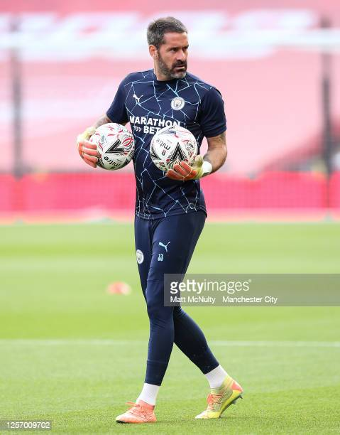Scott Carson of Manchester City warms up during the FA Cup Semi Final match between Arsenal and Manchester City at Wembley Stadium on July 18 2020 in...