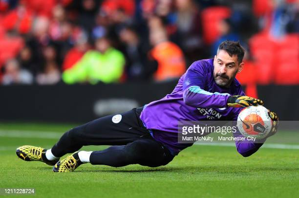 Scott Carson of Manchester City warms up during the Premier League match between Manchester United and Manchester City at Old Trafford on March 08...