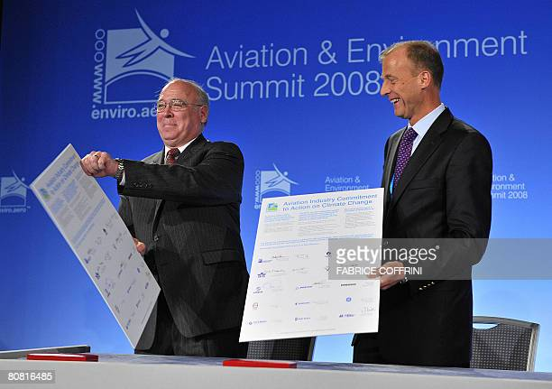 Scott Carson President and CEO of Boeing Commercial Airways smiles with Tom Enders President and CEO of Airbus during a signing ceremony at the third...