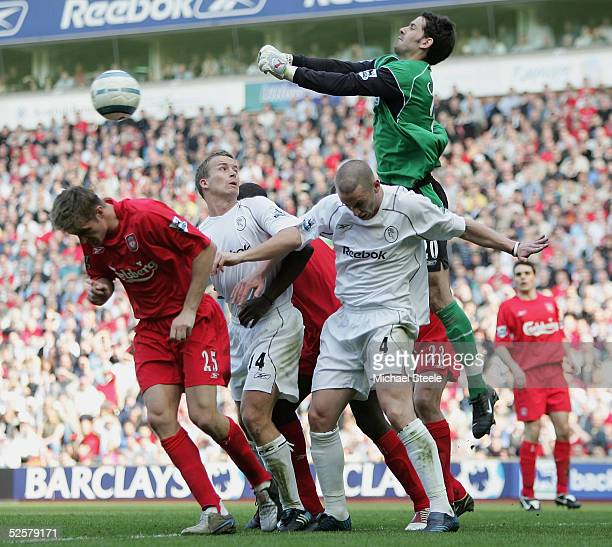 Scott Carson the Liverpool goalkeeper punches clear from Kevin Nolan and Kevin Davies of Bolton during the Barclays Premiership match between...