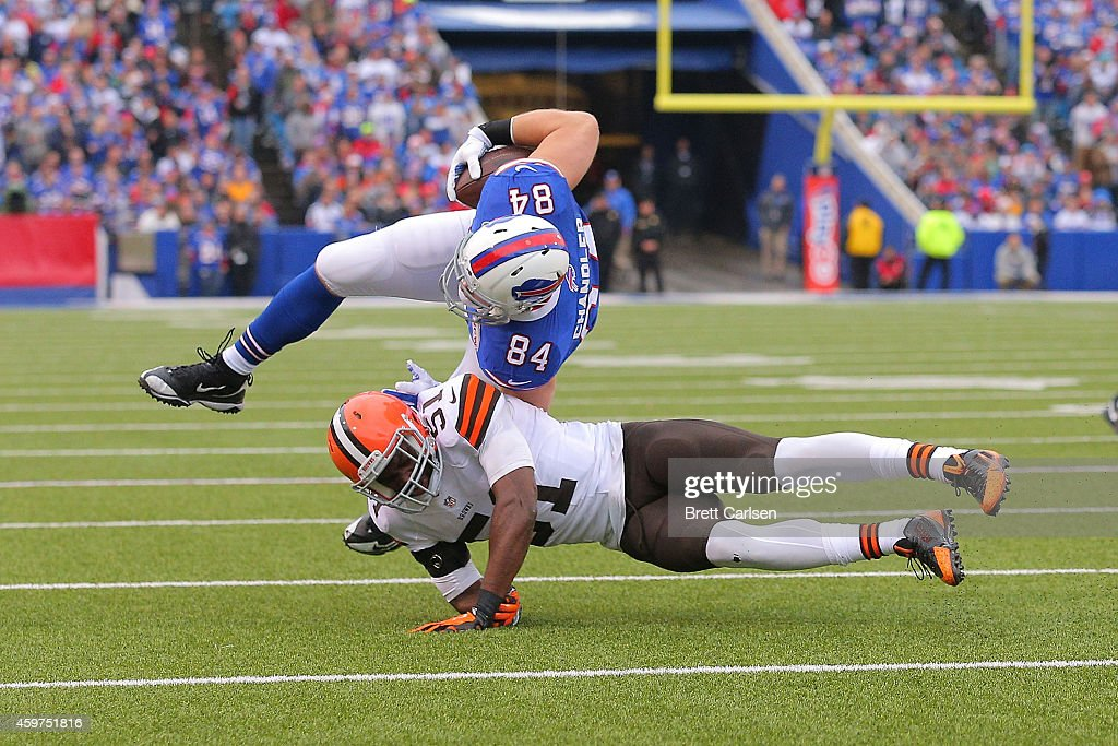 Scott Chandler #84 of the Buffalo Bills is tackled by Barkevious Mingo #51 of the Cleveland Browns during the first half at Ralph Wilson Stadium on November 30, 2014 in Orchard Park, New York.