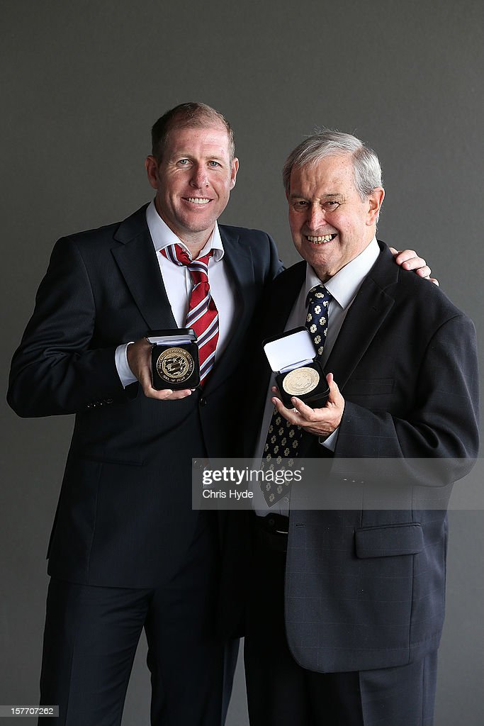 Scott Chipperfield and Alan Vessey pose with the Hall of Fame medal after being inducted into the 2012 Football Federation Australia Hall of Fame during a ceremony at Gambaro Restaurant and Function Centre on December 6, 2012 in Brisbane, Australia.