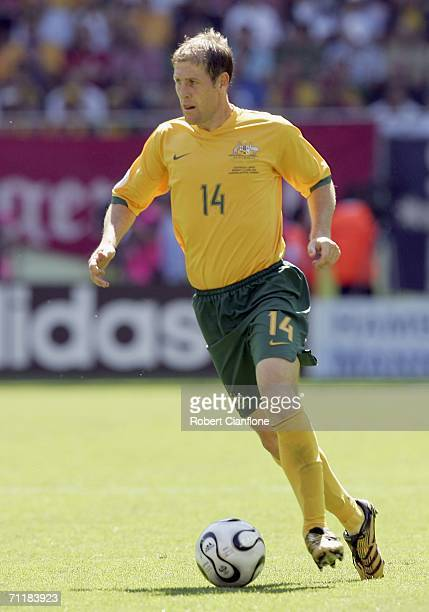 Scott Chipperfield of Australia runs with the ball during the FIFA World Cup Germany 2006 Group F match between Australia and Japan at the Fritz...