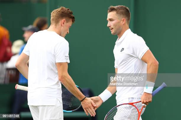 Scott Clayton and Liam Broady of Great Britain celebrate a point against Frances Tiafoe and Jackson Withrow of the United States during their Men's...