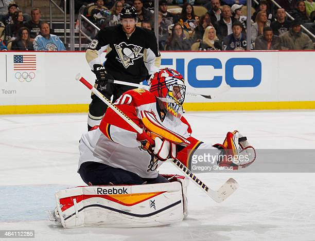 Scott Clemmensen of the Florida Panthers makes a glove save during the second period against the Pittsburgh Penguins on January 20 2014 at Consol...
