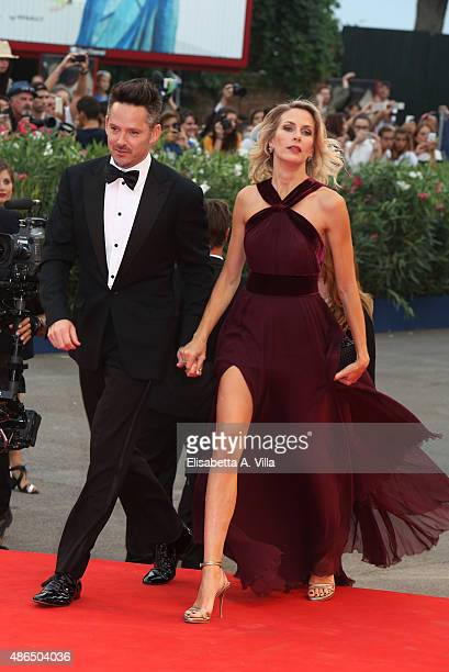 Scott Cooper and wife Jocelyne Cooper attend a premiere for 'Black Mass' during the 72nd Venice Film Festival on September 4 2015 in Venice Italy