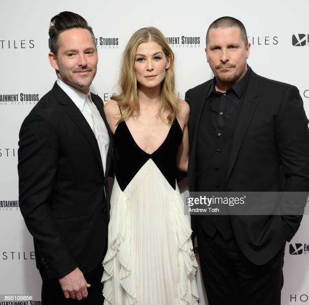 Scott Cooper Rosamund Pike and Christian Bale attend the 'Hostiles' premiere at Metrograph on December 18 2017 in New York City