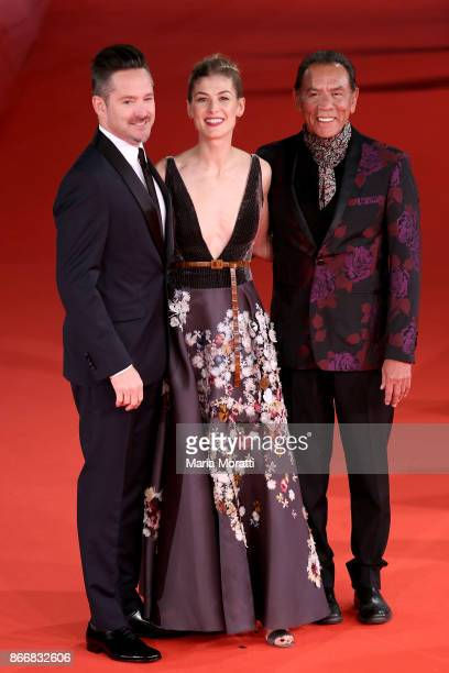 Scott Cooper Rosamund Pike and Wes Studi walk a red carpet for 'Hostiles' during the 12th Rome Film Fest at Auditorium Parco Della Musica on October...